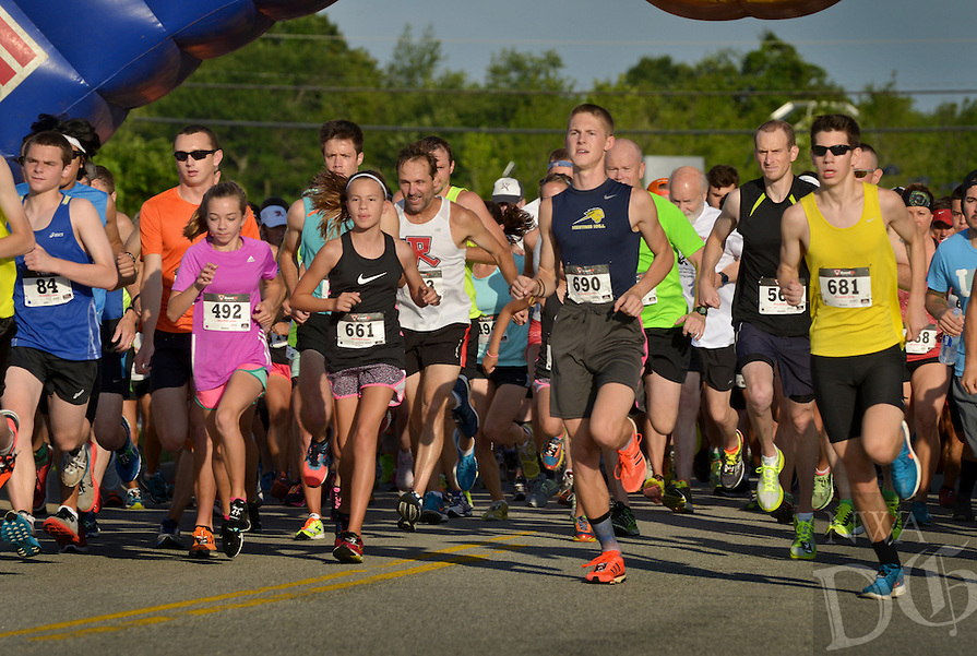 NWA Democrat-Gazette/BEN GOFF -- 06/13/15 Runners take off at the starting line on Saturday June 13, 2015 during The Cancer Challenge 10K, 5K Run & 1-Mile Walk at Memorial Park in Bentonville.