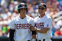 Oregon State Beavers head coach Pat Casey #5 smiles with shortstop Tyler Smith #1 during Game 5 of the 2013 Men's College World Series between the Oregon State Beavers and Louisville Cardinals at TD Ameritrade Park on June 17, 2013 in Omaha, Nebraska. The Beavers defeated the Cardinals 11-4. (Brace Hemmelgarn/Four Seam Images)