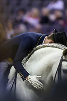 OMAHA, NEBRASKA - MAR 30: Joao Victor Marcari Oliva pats Xama Dos Pinhais after the FEI World Cup Dressage Final I at the CenturyLink Center on March 30, 2017 in Omaha, Nebraska. (Photo by Taylor Pence/Eclipse Sportswire/Getty Images)