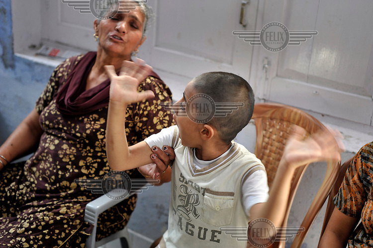 A child with birth defects sits with his mother in the waiting room of the privately funded Baba Farid Centre in Faridkot. An increasing and ignored percentage of children are being born suffering the side effects of industrial pollution. The Baba Farid Centre was set up by Dr Pritpal Singh and is staffed on a volunteer basis by his network of similarly concerned fellow junior doctors and specialists. It treats its patients with a mixture of homeopathic, ayurvedic and acupuncture methods.