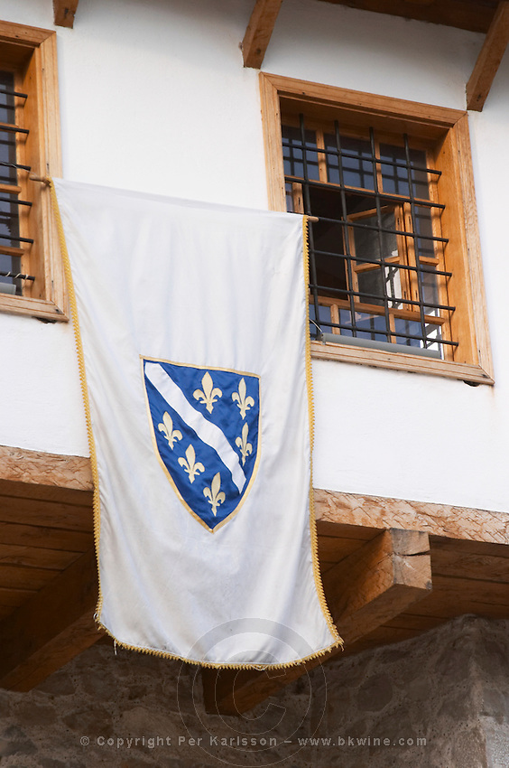 A flag hanging from the 'shop tower' near the old bridge. Historic town of Mostar. Federation Bosne i Hercegovine. Bosnia Herzegovina, Europe.