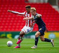 4th July 2020; Bet365 Stadium, Stoke, Staffordshire, England; English Championship Football, Stoke City versus Barnsley; Tyrese Campbell of Stoke City under pressure from Ben Williams of Barnsley