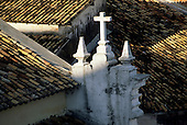 Salvador, Bahia, Brazil. Pelourinho roofs with a colonial cross.