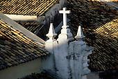 Salvador, Bahia, Brazil. Pelourinho roofs with a colonial cross.