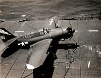 SB2C-4E replacement #80 (original crashed by Evens in Feb 1945) of Bombing Squadron 85 (VB-85) pictured after a barrier crash aboard USS Shangri-La (CV-38) near Pearl Harbor Hawaii - March (13?), 1945