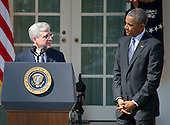 United States President Barack Obama, right, listens as Judge Merrick Garland, chief justice for the US Court of Appeals for the District of Columbia Circuit, left, was announced as his nominee to replace the late Associate Justice Antonin Scalia on the U.S. Supreme Court in the Rose Garden of the White House in Washington, D.C. on Wednesday, March 16, 2016. <br />
