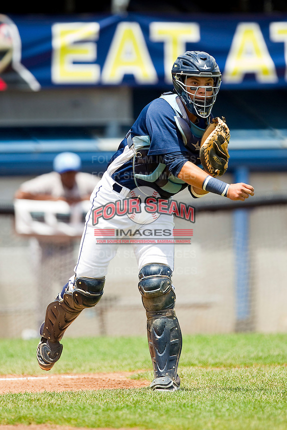 Princeton Rays catcher Oscar Hernandez (28) makes a throw to first base against the Burlington Royals at Hunnicutt Field on July 15, 2012 in Princeton, West Virginia.  The Royals defeated the Rays 2-0 in game one of a double header.  (Brian Westerholt/Four Seam Images)