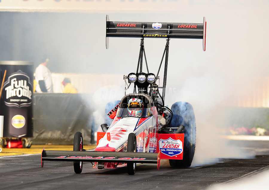 Feb. 24, 2011; Pomona, CA, USA; NHRA top fuel dragster driver Shawn Langdon does a burnout during qualifying for the Winternationals at Auto Club Raceway at Pomona. Mandatory Credit: Mark J. Rebilas-