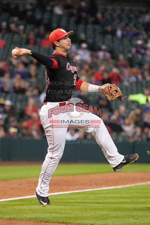 Houston Cougars third baseman Justin Montemayor (20) makes a tough throw to first base during the NCAA baseball game against the LSU Tigers on March 6, 2015 at Minute Maid Park in Houston, Texas. LSU defeated Houston 4-2. (Andrew Woolley/Four Seam Images)