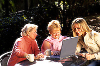 Authentic family portrait of four generations playing computer ages 97 72 48 2