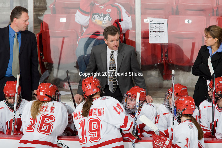 MADISON, WI - NOVEMBER 2: Head coach Mark Johnson of the Wisconsin Badgers women's hockey team talks to his team during a timeout against the Minnesota Golden Gophers at the Kohl Center on November 2, 2007, in Madison, Wisconsin. The Badgers beat the Golden Gophers 3-0. (Photo by David Stluka)