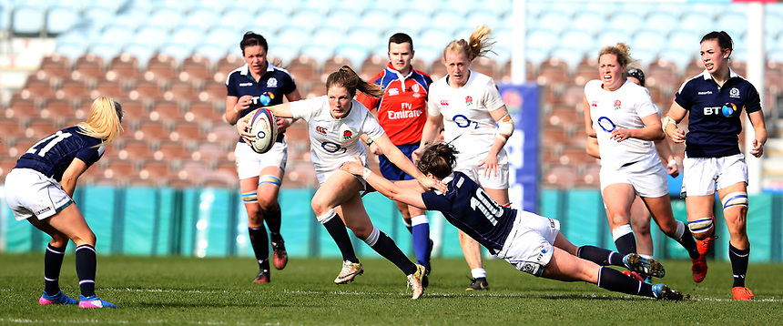 England Women's Lydia Thompson is tackled by Scotland Women's Helen Nelson<br /> <br /> Photographer Stephen White/CameraSport<br /> <br /> Women's Six Nations Round 4 - England Women v Scotland Women - Saturday 11th March 2017 - The Stoop - London<br /> <br /> World Copyright &copy; 2017 CameraSport. All rights reserved. 43 Linden Ave. Countesthorpe. Leicester. England. LE8 5PG - Tel: +44 (0) 116 277 4147 - admin@camerasport.com - www.camerasport.com