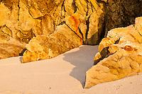 Close up of rocks on the wild West Coast beach - South Westland, West Coast, New Zealand