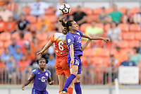 Houston, TX - Saturday June 17, 2017: Marta Vieira Da Silva and Morgan Brian go up for a header during a regular season National Women's Soccer League (NWSL) match between the Houston Dash and the Orlando Pride at BBVA Compass Stadium.