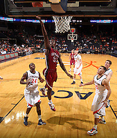 Nov 6, 2010; Charlottesville, VA, USA; Roanoke College g Melvin Felix (12) shoots the ball in front of Virginia Cavaliers g KT Harrell (24) Saturday afternoon in exhibition action at John Paul Jones Arena. The Virginia men's basketball team recorded an 82-50 victory over Roanoke College.