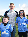 Dublin player Paul Flynn with Cian and Megan Reid of Newtown Blues GFC. Photo:Colin Bell/pressphotos.ie