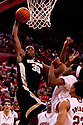 30 November 2011: Travis McKie #30 of the Wake Forest Demon Deacons with a lay up against David Rivers #2 of the Nebraska Cornhuskers at the Devaney Sports Center in Lincoln, Nebraska. Wake Forest defeated Nebraska 55 to 53.