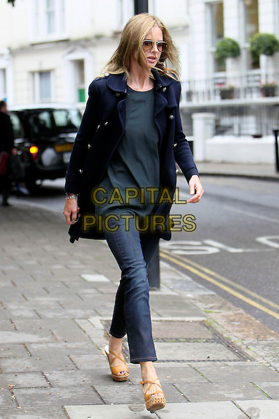 TRINNY WOODALL.Spotted on the school run, London, England..June 13th, 2011.full length jeans denim beige wedges sunglasses shades top blue jacket walking .CAP/HIL.©John Hillcoat/Capital Pictures .