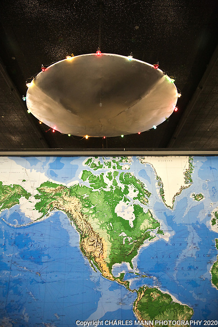 The Roswell UFO Museum features a UFO light fixture hovering above a map of the world.