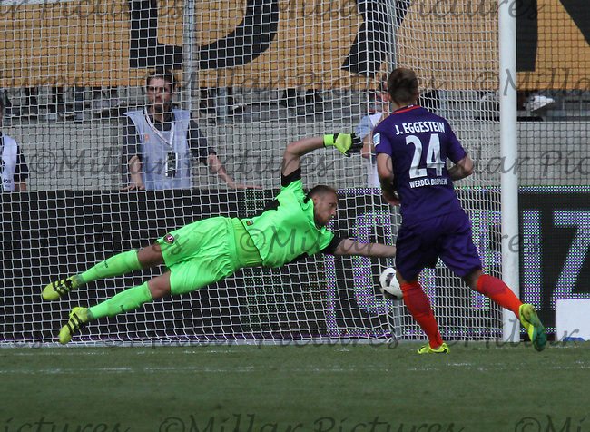 Johannes Eggestein scores past Marvin Schwäbe for the winner in the penalty shootout in the Dynamo Dresden v Werder Bremen match in the Bundeswehr Karriere Cup Dresden 2016 played at the DDV Stadion, Dresden on 30.7.16.