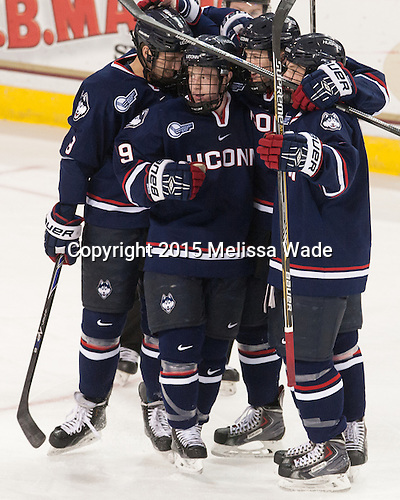 The Huskies celebrate Ryan Segalla's (UConn - 3) goal. - The Boston College Eagles defeated the visiting University of Connecticut Huskies 3-2 on Saturday, January 24, 2015, at Kelley Rink in Conte Forum in Chestnut Hill, Massachusetts.