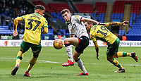 Bolton Wanderers' Joe Williams competing with Norwich City's Max Aarons  <br /> <br /> Photographer Andrew Kearns/CameraSport<br /> <br /> The EFL Sky Bet Championship - Bolton Wanderers v Norwich City - Saturday 16th February 2019 - University of Bolton Stadium - Bolton<br /> <br /> World Copyright © 2019 CameraSport. All rights reserved. 43 Linden Ave. Countesthorpe. Leicester. England. LE8 5PG - Tel: +44 (0) 116 277 4147 - admin@camerasport.com - www.camerasport.com