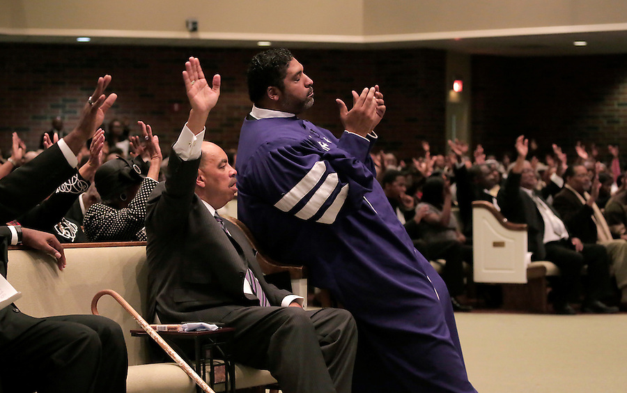 CHARLOTTE, NC - NOVEMBER 2:  The Rev. William Barber II, front right, president of the North Carolina NAACP, prays near Gregory K. Moss, Sr., front left, pastor of St. Paul Baptist Church, and congregants at the church in Charlotte, NC, on Sunday, November 2, 2014.  Barber has been instrumental as an activist for voter rights.  (Photo by Ted Richardson/For The Washington Post)