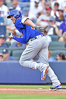 Chicago Cubs third baseman Kris Bryant (17) runs to first during a game against the Atlanta Braves at Turner Field on June 11, 2016 in Atlanta, Georgia. The Cubs defeated the Braves 8-2. (Tony Farlow/Four Seam Images)