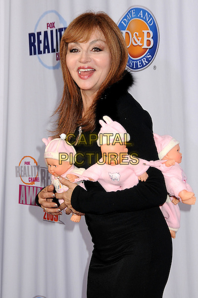 JUDY TENUTA.2009 Fox Reality Channel Really Awards held at the Music Box Theatre, Hollywood, California, USA..October 13th, 2009.half length  black dress babies wrap mouth open scarf necklace string dolls stuffed funny.CAP/ADM/BP.©Byron Purvis/AdMedia/Capital Pictures.