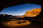 False Kiva at Canyonlands National Park in Utah, USA. This is a native american sacred space off the beaten path in the park, image photographed by the light of the full moon and a headlamp.