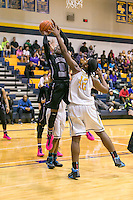 Cedar Ridge's Lashann Higgs attempts to shoot over Stony Point's Jordan Moore Friday at Stony Point Gym.  (LOURDES M SHOAF for Statesman)