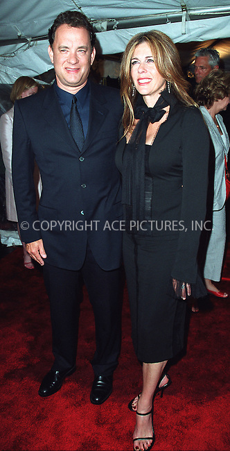 "Tom Hanks and wife Rita Wilson attending a special screening of ""Road to Perditon"" to benefit the Association of the HITWG Camps and the International Rescue Committee. New York, July 9, 2002.  Please byline: Alecsey Boldeskul/NY Photo Press.   ..*PAY-PER-USE*      ....NY Photo Press:  ..phone (646) 267-6913;   ..e-mail: info@nyphotopress.com"