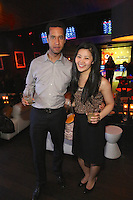 Biere-Yves Brunet and Lisa Ly attend the Happy Groups Launch Party at the Luxe Lounge at Lucky Strike, on May 22 in New York City.