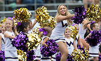 A cheer squad member gets a little help during a timeout.