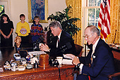 """United States President Bill Clinton delivers his weekly radio address on tobacco live from the Oval Office of the White House in Washington, DC on Saturday, August 12, 1995.  He was accompanied by Victor Crawford, a former tobacco lobbyist, who also spoke during the address.  In his remarks, the President discussed his proposed restrictions on the advertising, marketing, and sales of cigarettes to children following a 14 month FDA study """"which found tobacco addictive, harmful, and readily available to young Americans.""""<br /> Mandatory Credit: Robert McNeely / White House via CNP"""