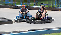 NWA Democrat-Gazette/J.T. WAMPLER Maecy Garner ((CQ)) of Farmington (right) takes the lead while racing go-carts with Dallas Taylor of Stillwell Tuesday August 8, 2017 at Locomotion in Fayetteville. School begins next week for Garner and today ((WEDNESDAY AUG 9)) for Taylor.