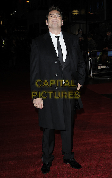 "JAVIER BARDEM.At the ""Biutiful"" premiere during the 54th BFI London Film Festival, Vue West End Cinema, London, England, UK, .26th October 2010..full length black suit tie white shirt coat .CAP/CAN.©Can Nguyen/Capital Pictures."