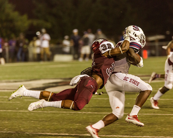 September 21, 2017. Durham, North Carolina.<br /> <br /> Defensive back for NCCU #32 Alden McClellon drags down South Carolina State player. <br /> <br /> The NCCU Eagles won a home game against the the South Carolina State Bulldogs 33-28 at O'Kelly–Riddick Stadium.