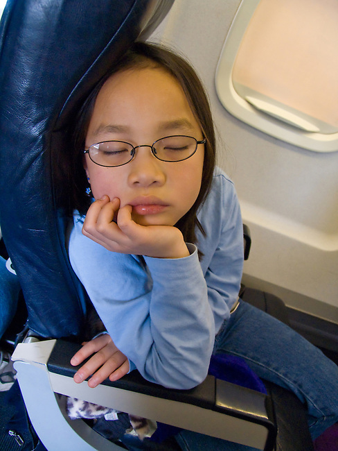 young girl, asleep, airplane ride, (MR# 96)