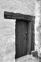 Door in gardens at the Carmel Mission. Carmel by the Sea, California.