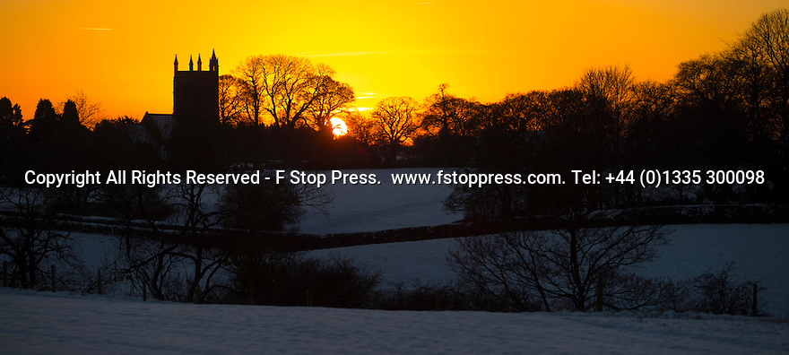 28/12/14<br /> <br /> The sun sets ahead of what is forecast to be the coldest night of the year behind, a snow covered fields at Saint Martin's Church, Osmaston, Derbyshire.<br /> <br /> <br /> All Rights Reserved - F Stop Press. www.fstoppress.com. Tel: +44 (0)1335 300098