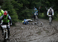 A man takes a tumble in the mud. The interest for mountain bike races has exploded in Norway the last few years, particularly with middle age affluent men. The biggest is called Birkebeinerrittet, or Birken, a race of 94,6 km and 14.500 participants, and was fully booked in 41 seconds. This years race proved to be hardest ever with constant rain and low temperatures.