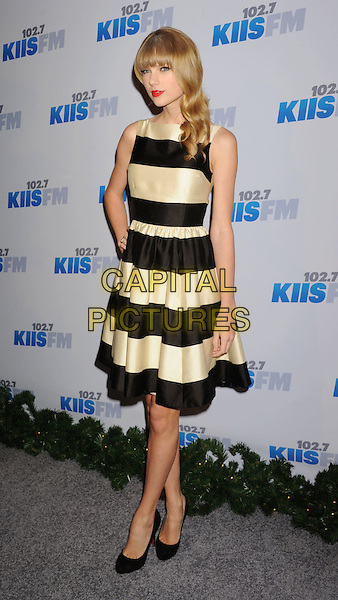 Taylor Swift .arriving at KIIS FM's 2012 Jingle Ball at Nokia Theatre L.A. Live in Los Angeles, California, USA..1st December 2012.full length black white striped stripes dress sleeveless hand on hip.CAP/ROT/TM.© TM/Roth/Capital Pictures
