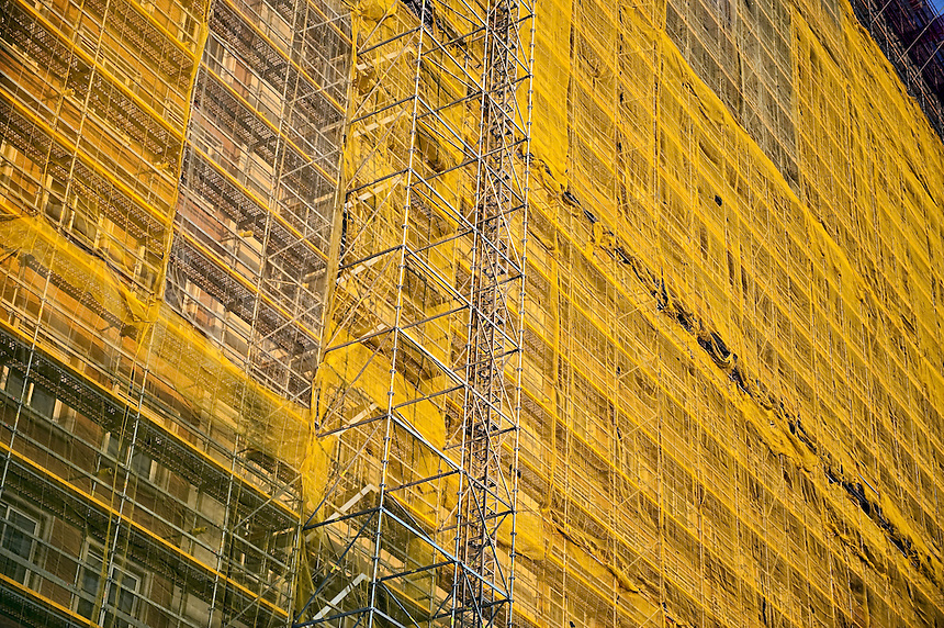 Buildings undergoing restoration covered in scaffolding and mesh fabric, Madrid, Spain