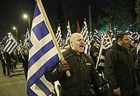 Members of far right group Golden Dawn (Chrysi Avgi) march