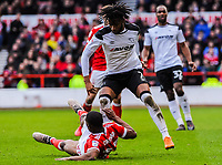 Nottingham Forest's defender Tendayi Darikwa (27) fouls Derby County's midfielder Kasey Palmer (7) during the Sky Bet Championship match between Nottingham Forest and Derby County at the City Ground, Nottingham, England on 10 March 2018. Photo by Stephen Buckley / PRiME Media Images.