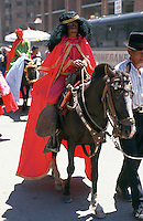 A child dressed as one of the Three Kings rides a horse in a Christmas parade, Cuenca.