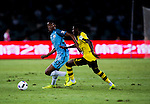 Borussia Dortmund striker Ousmane Dembele (l) fights for the ball with Manchester City Tosin Adarabioyo (r) during the match between Manchester City FC during their 2016 International Champions Cup China match at the Shenzhen Stadium on 28 July 2016 in Shenzhen, China. Photo by Marcio Machado / Power Sport Images