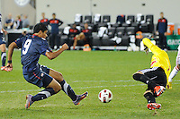 Mario Rodriguez (9) of the USA shoots and scores. The USMNT U-17 defeated New York Red Bulls U-18 4-1 during a friendly at Red Bull Arena in Harrison, NJ, on October 09, 2010.