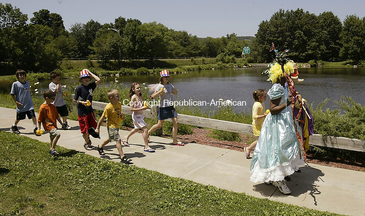 TORRINGTON, CT 10 July 2005 -071005BZ08- Kids carrying rubber ducks took part in a &quot;duck parade&quot; preceeding the start of the duck race at Artwell's Seventh Annual Floating Artwork Regatta held at Besse Pond in Torrington  Sunday afternoon. <br /> Jamison C. Bazinet Photo